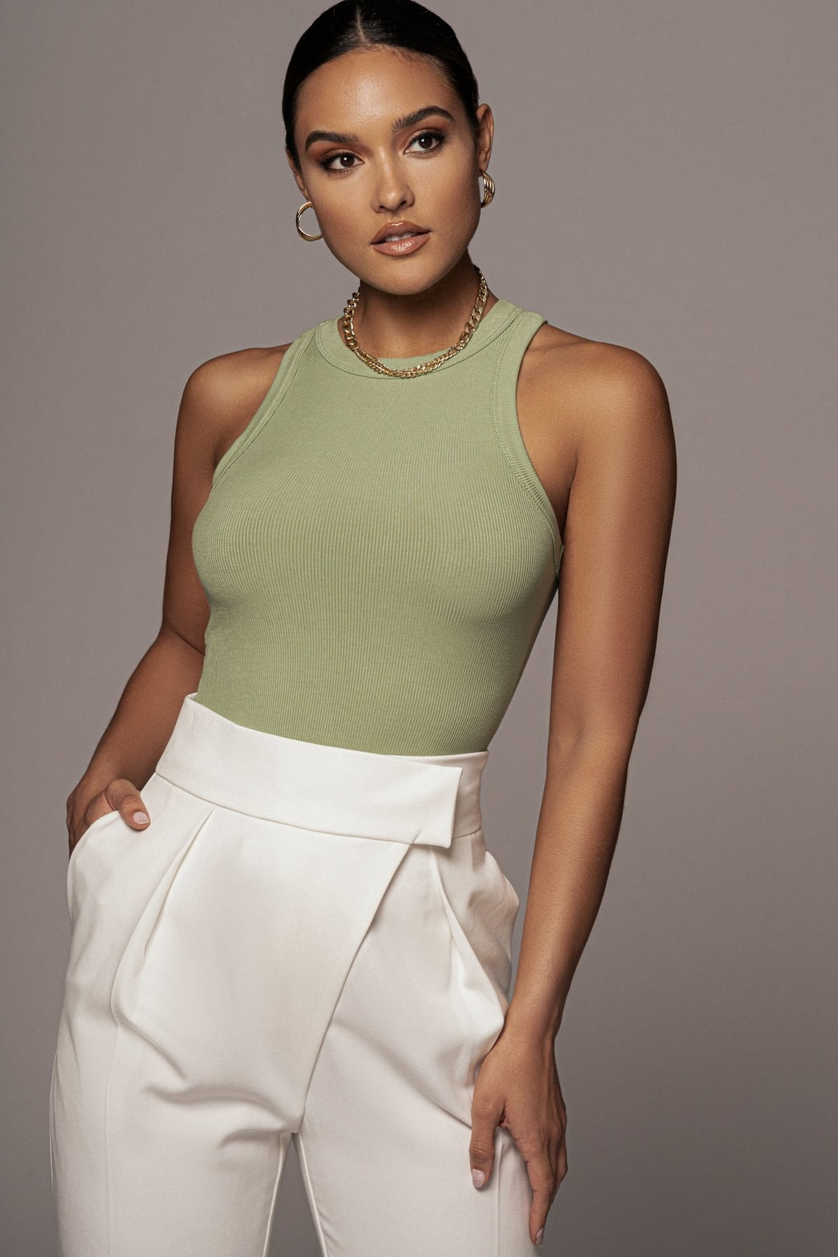 A model wearing the green tank