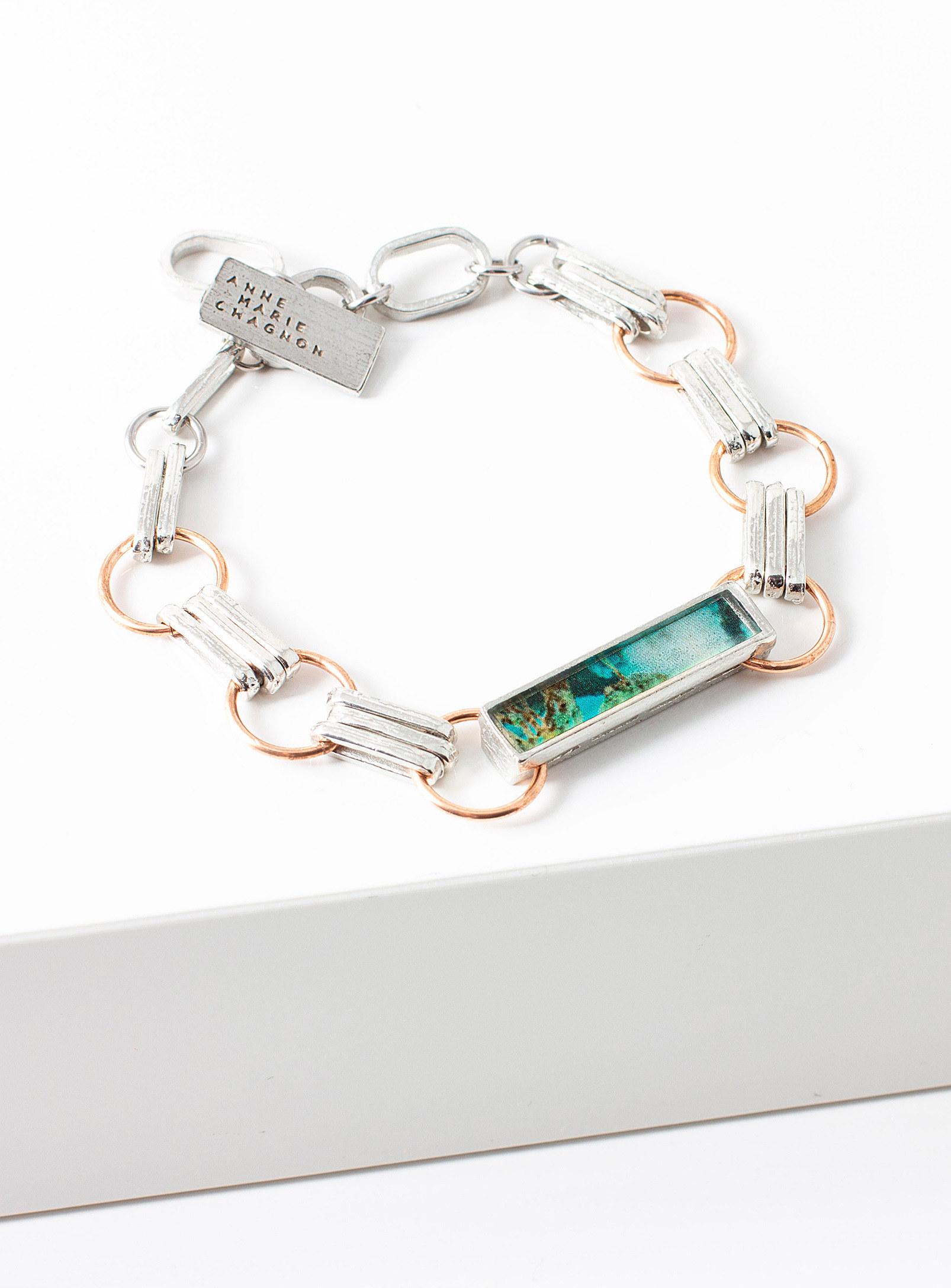 A chunky chain bracelet on a small table