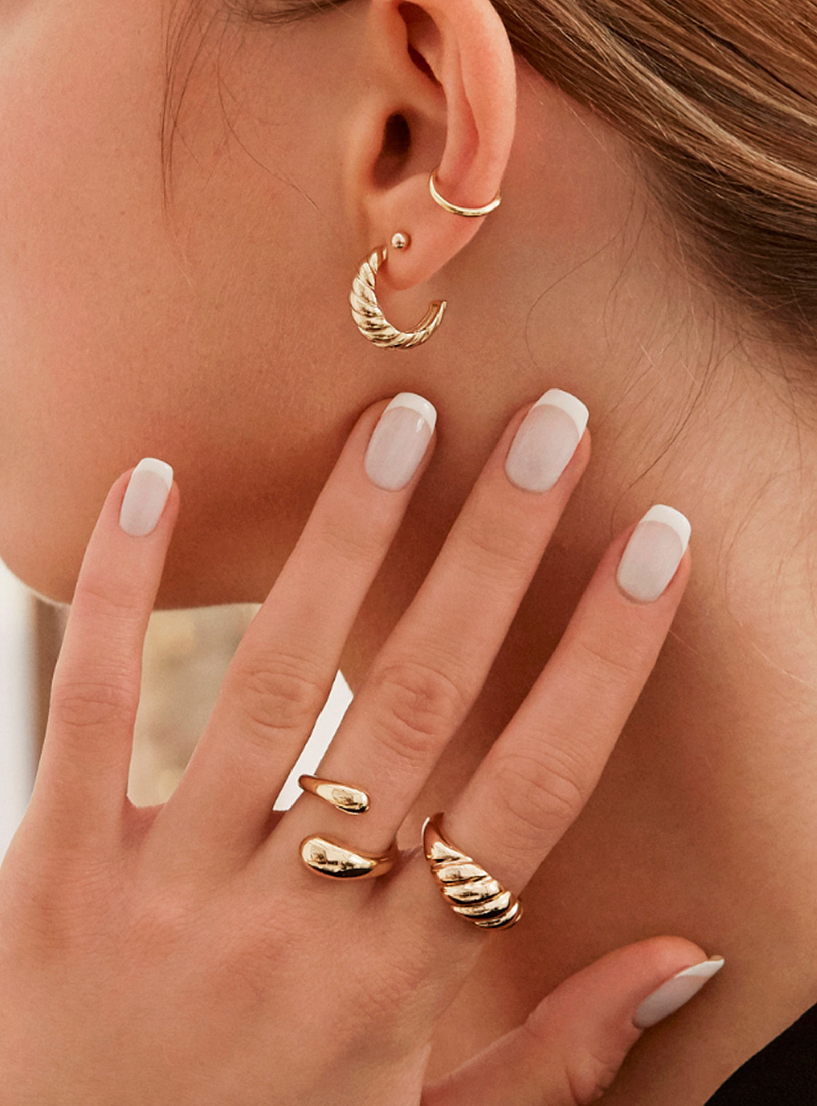 A person wearing two rings on their fingers
