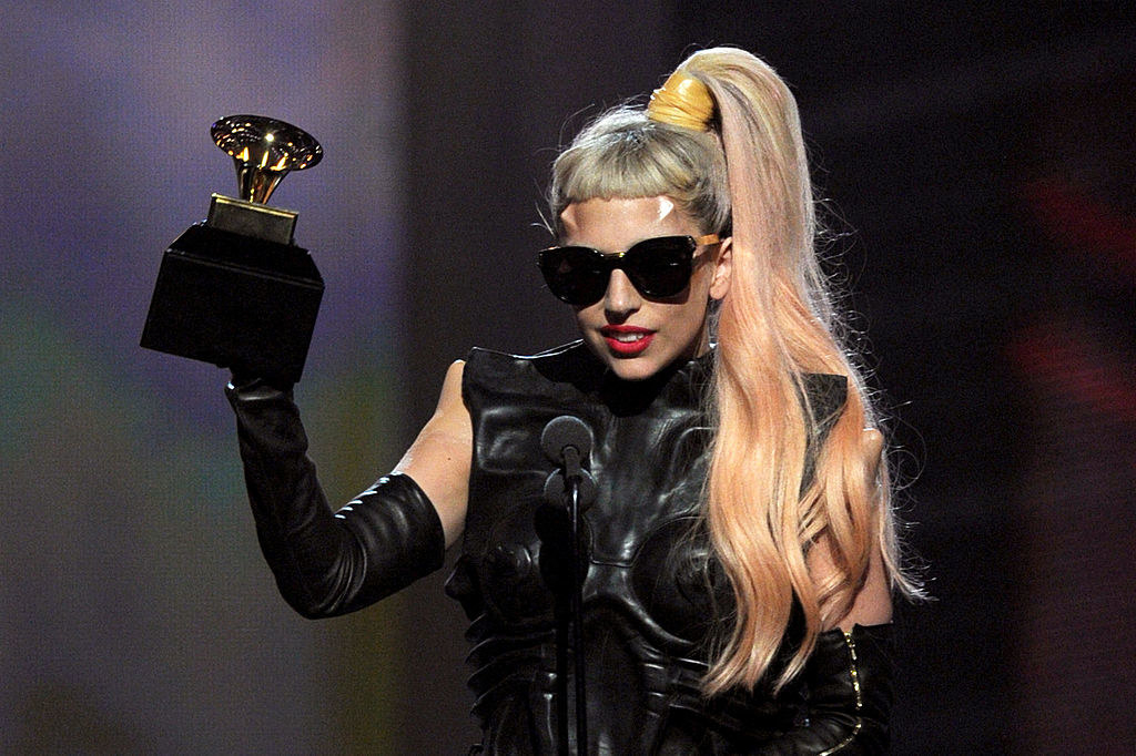 Lady Gaga accepting her award onstage