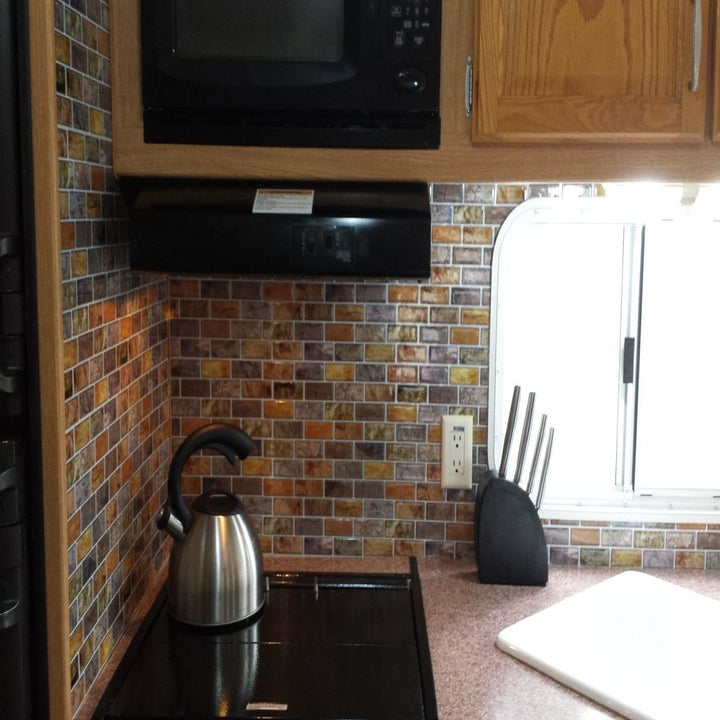 After: a wall decorated with tiles
