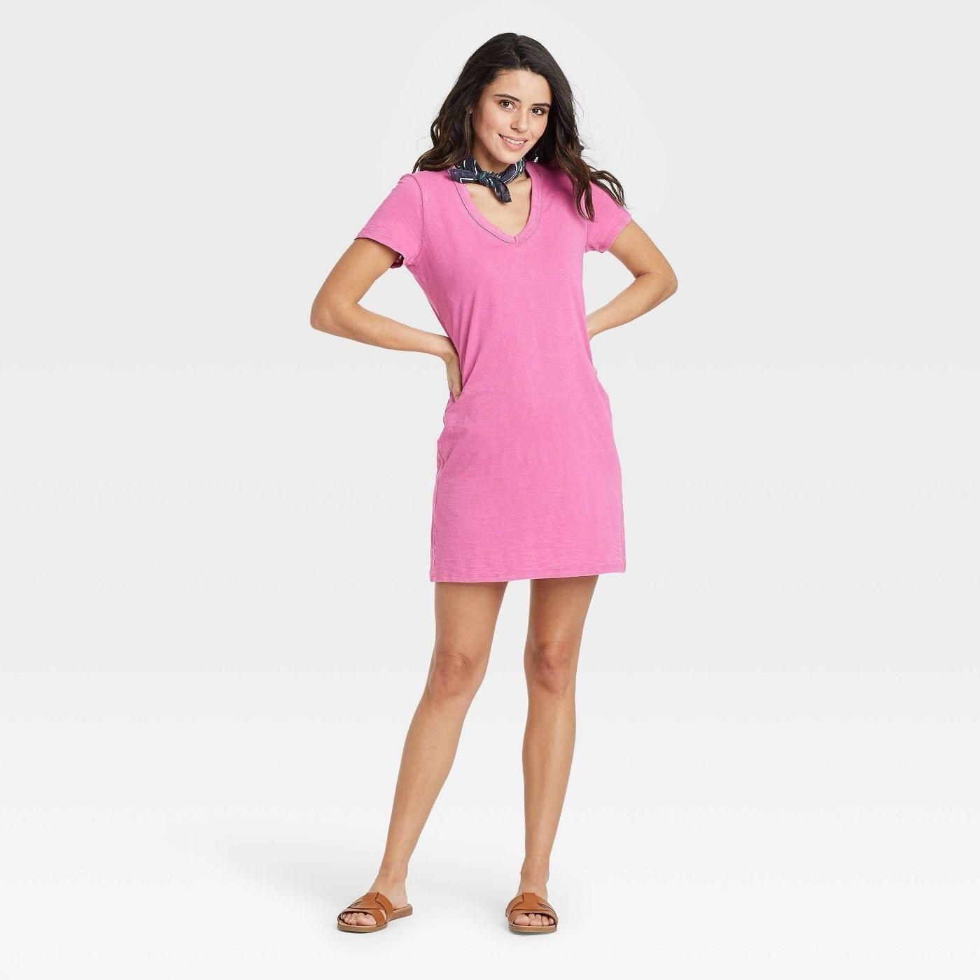 Model wearing pink mini dress