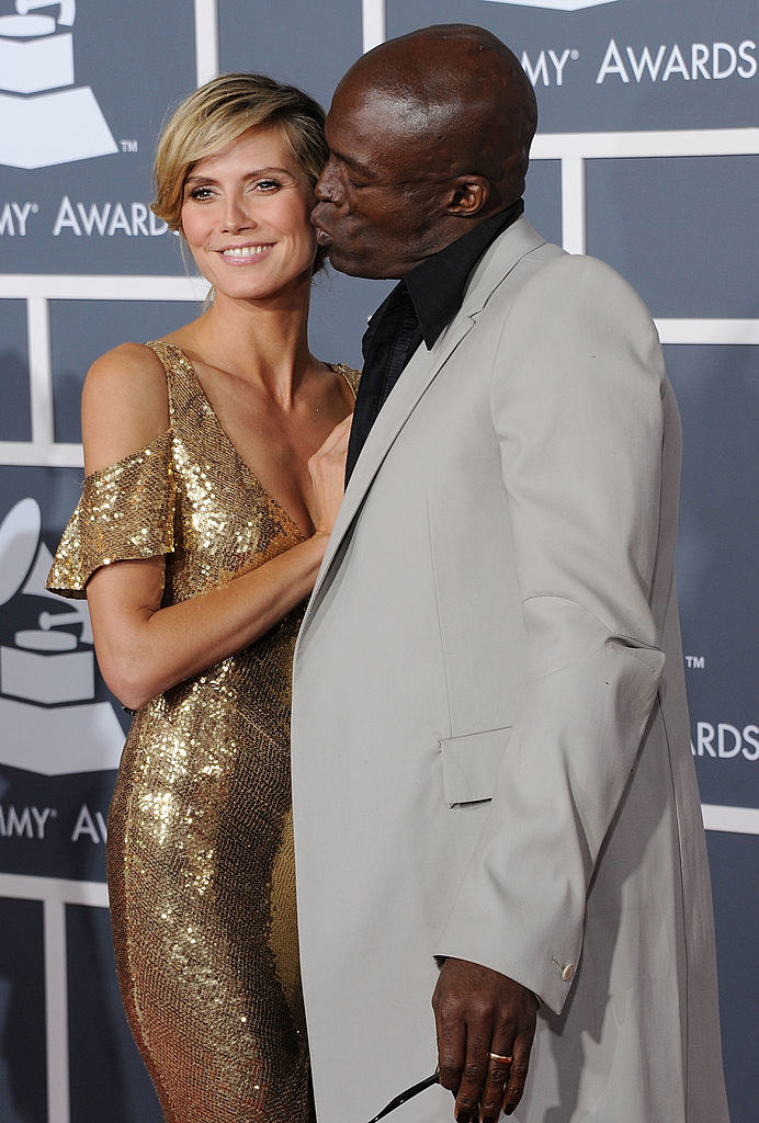 Seal giving Heidi a kiss on the cheek as they stand on the red carpet