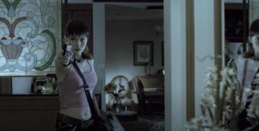 Woman pointing a gun.