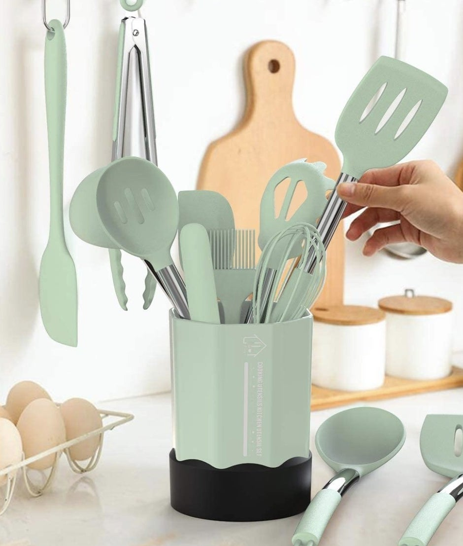 A mint green set of cooking utensils on a kitchen counter