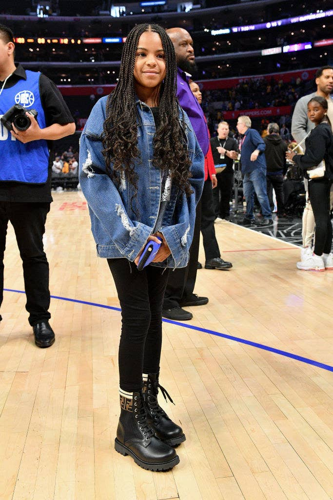Blue Ivy standing on the court at an NBA basketball court