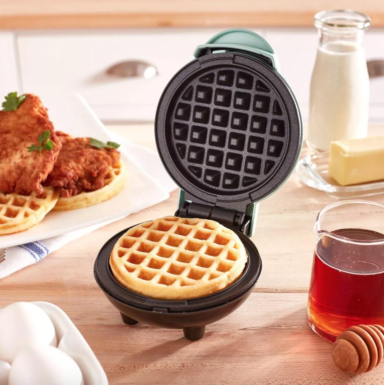 """A small 4"""" waffle iron"""