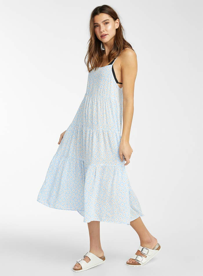 A person wearing a sundress with sandals