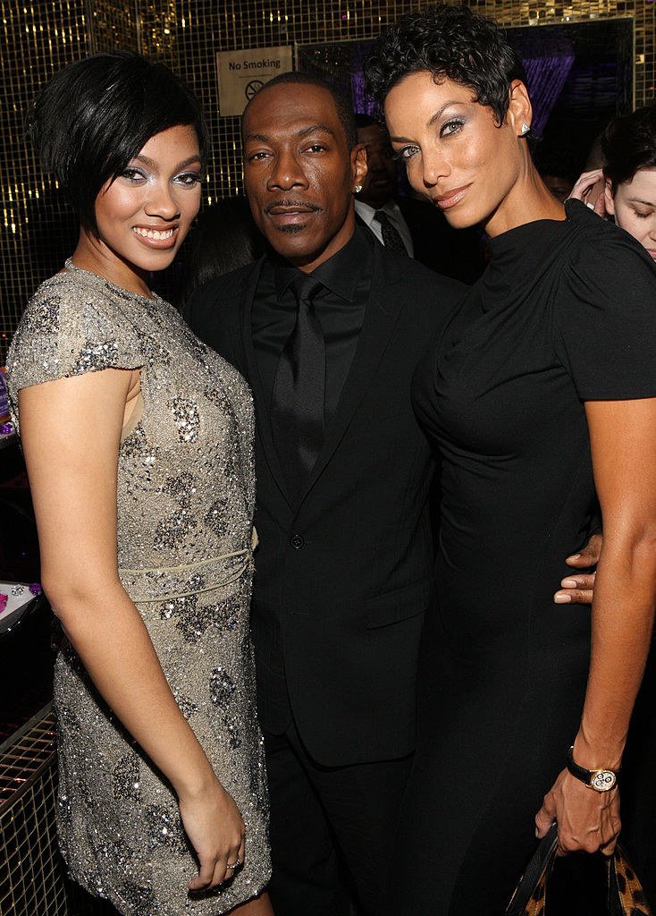 Bria Murphy, Eddie Murphy, and Nicole Murphy attend a SoftSheen-Carson Dark and Lovely event