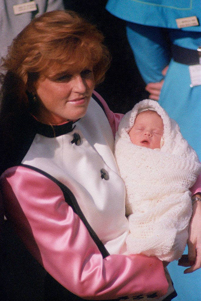 Sarah, Duchess of York leaves the Portland Hospital in London with her new daughter, Princess Eugenie, 30th March 1990