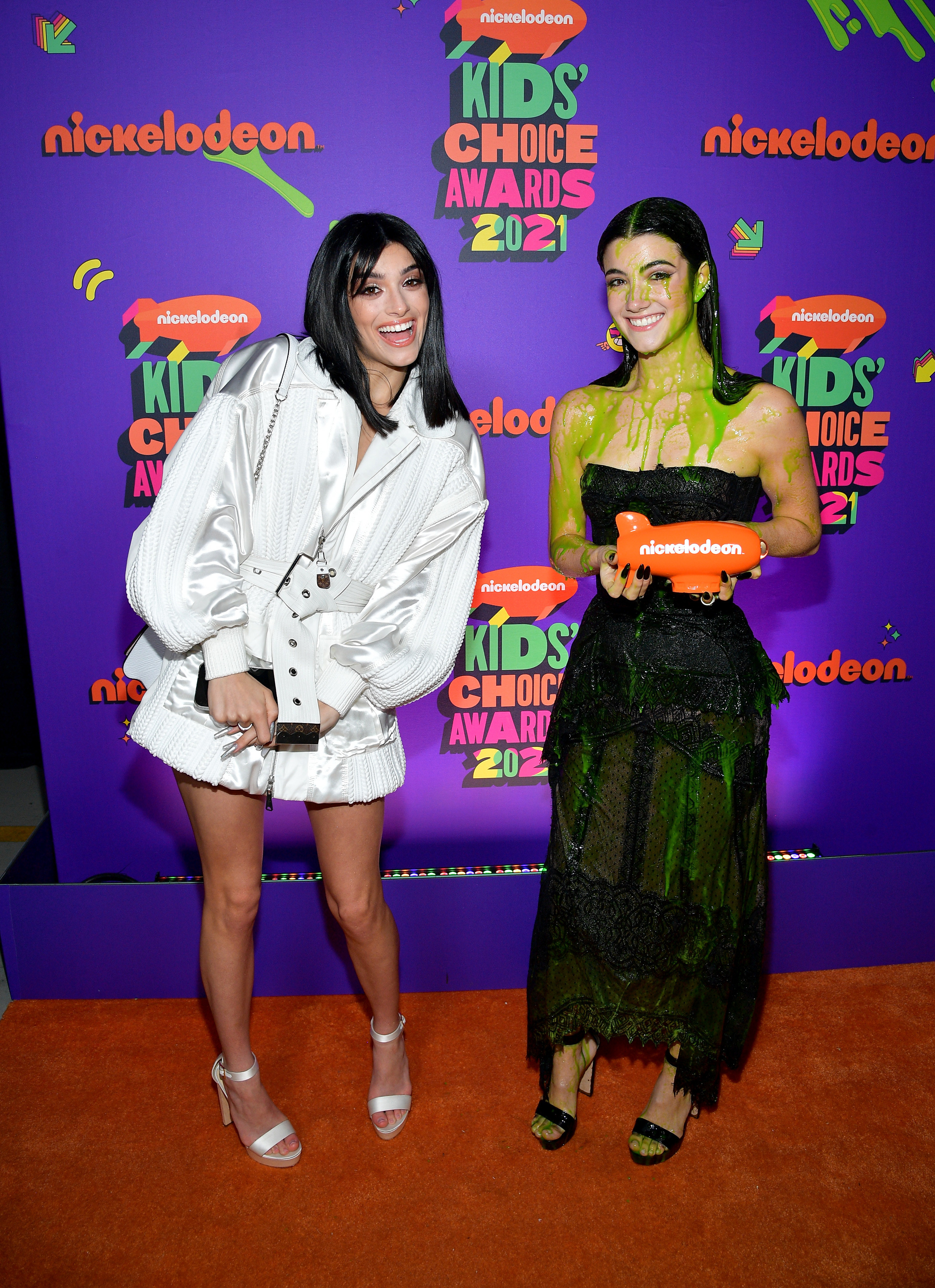 Dixie posing next to Charli after Charli was slimed