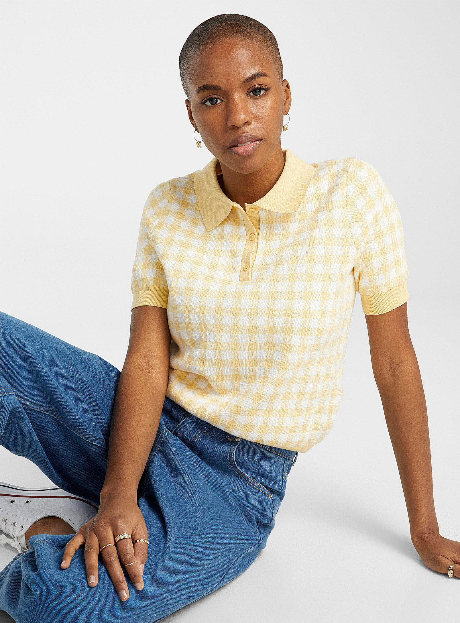 A person wearing a polo shirt with jeans