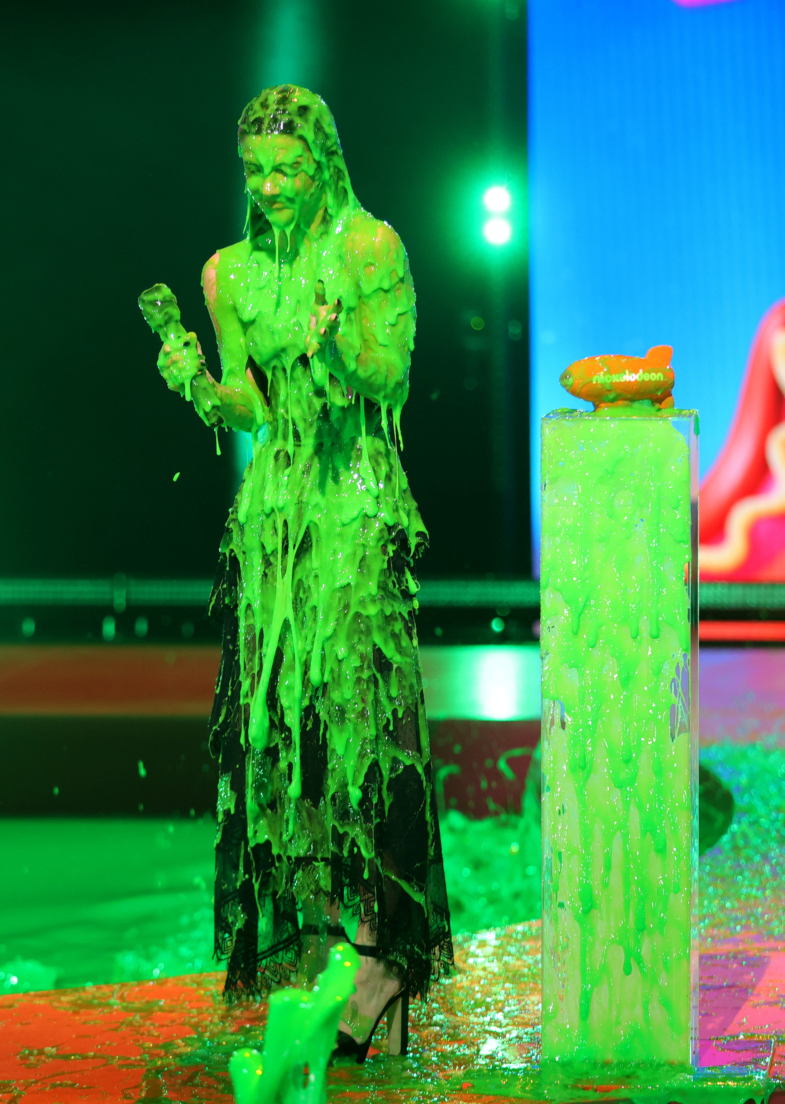 Charli completely covered in slime onstage