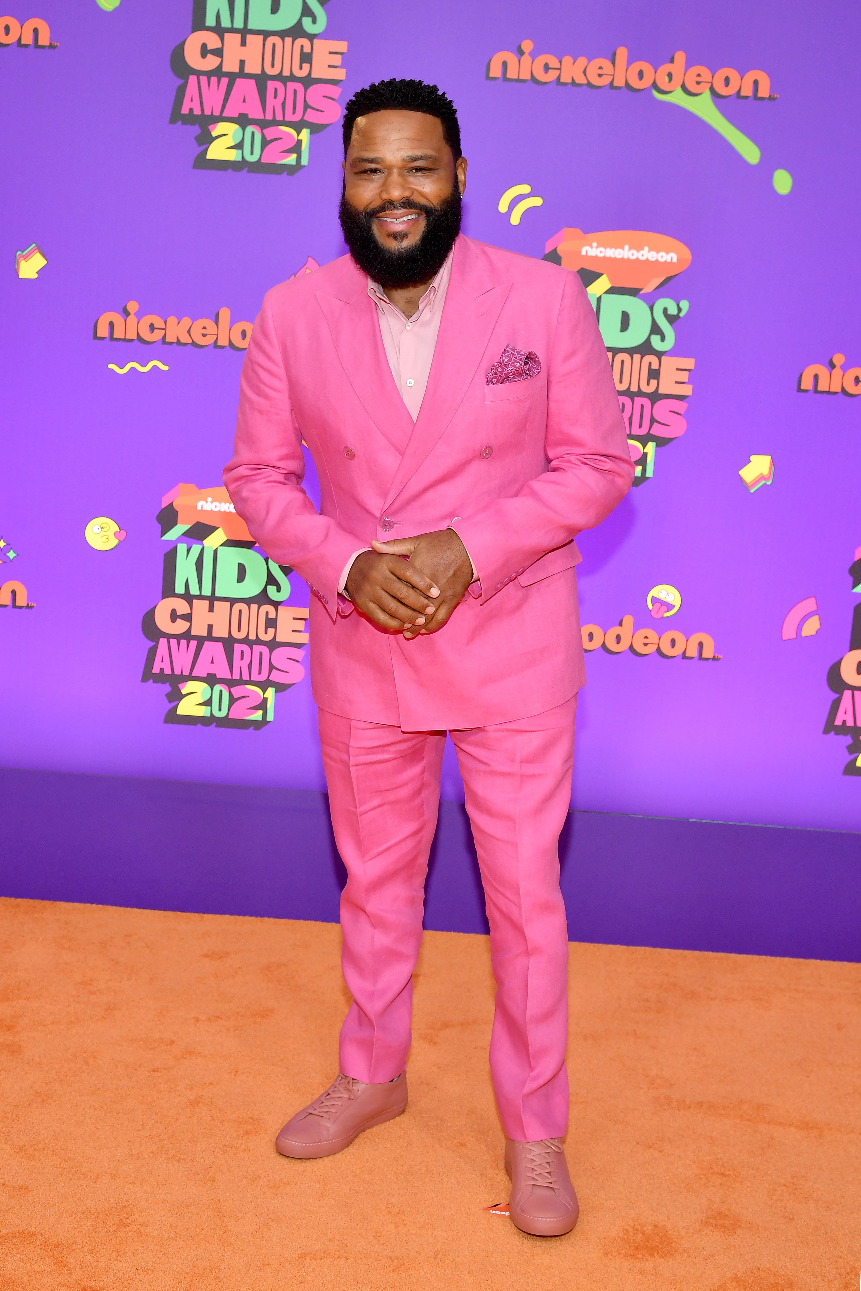 Anthony in a pink suit paired with a pink button down and pink shoes