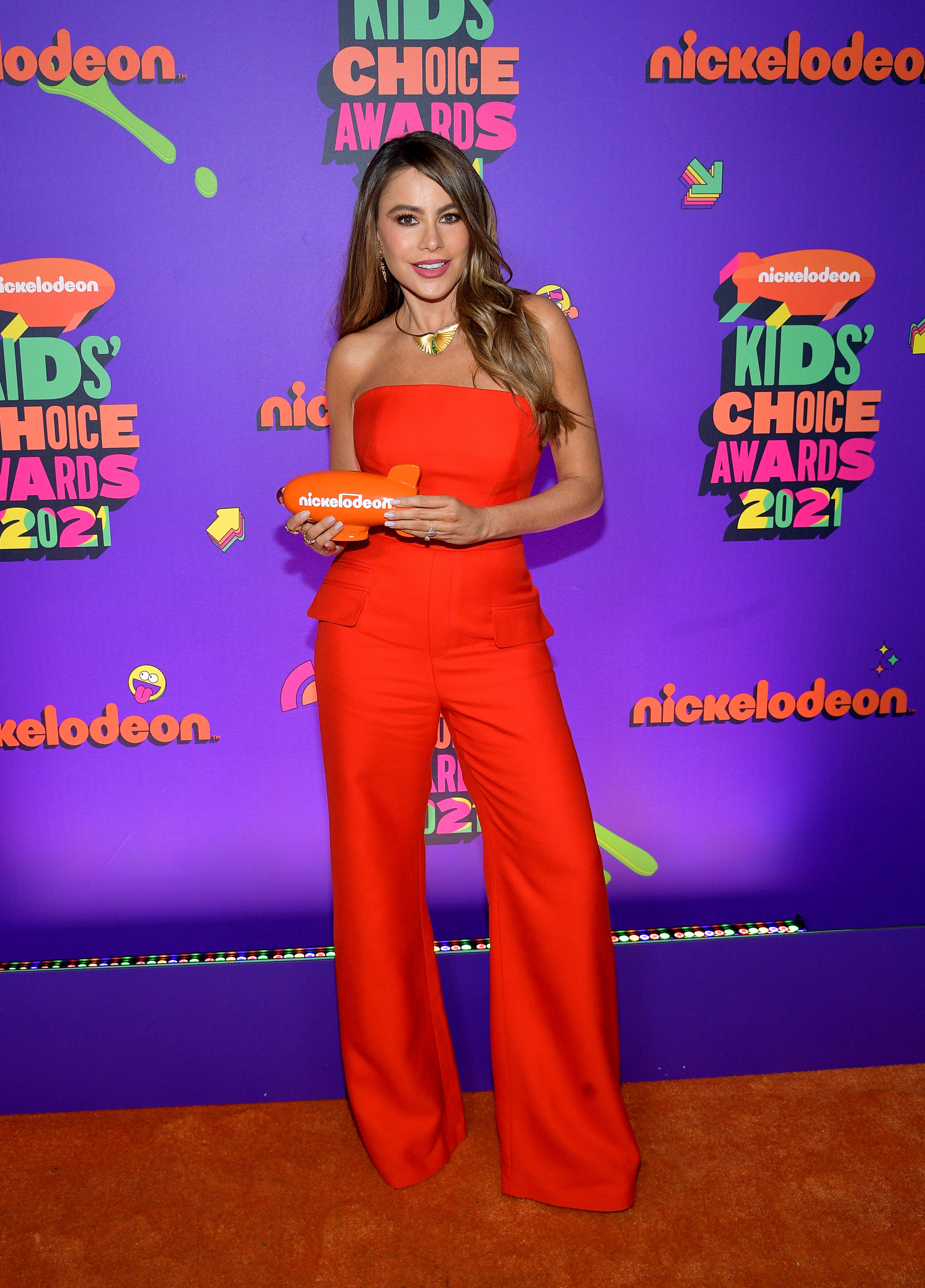 Sofia in a strapless red jumpsuit