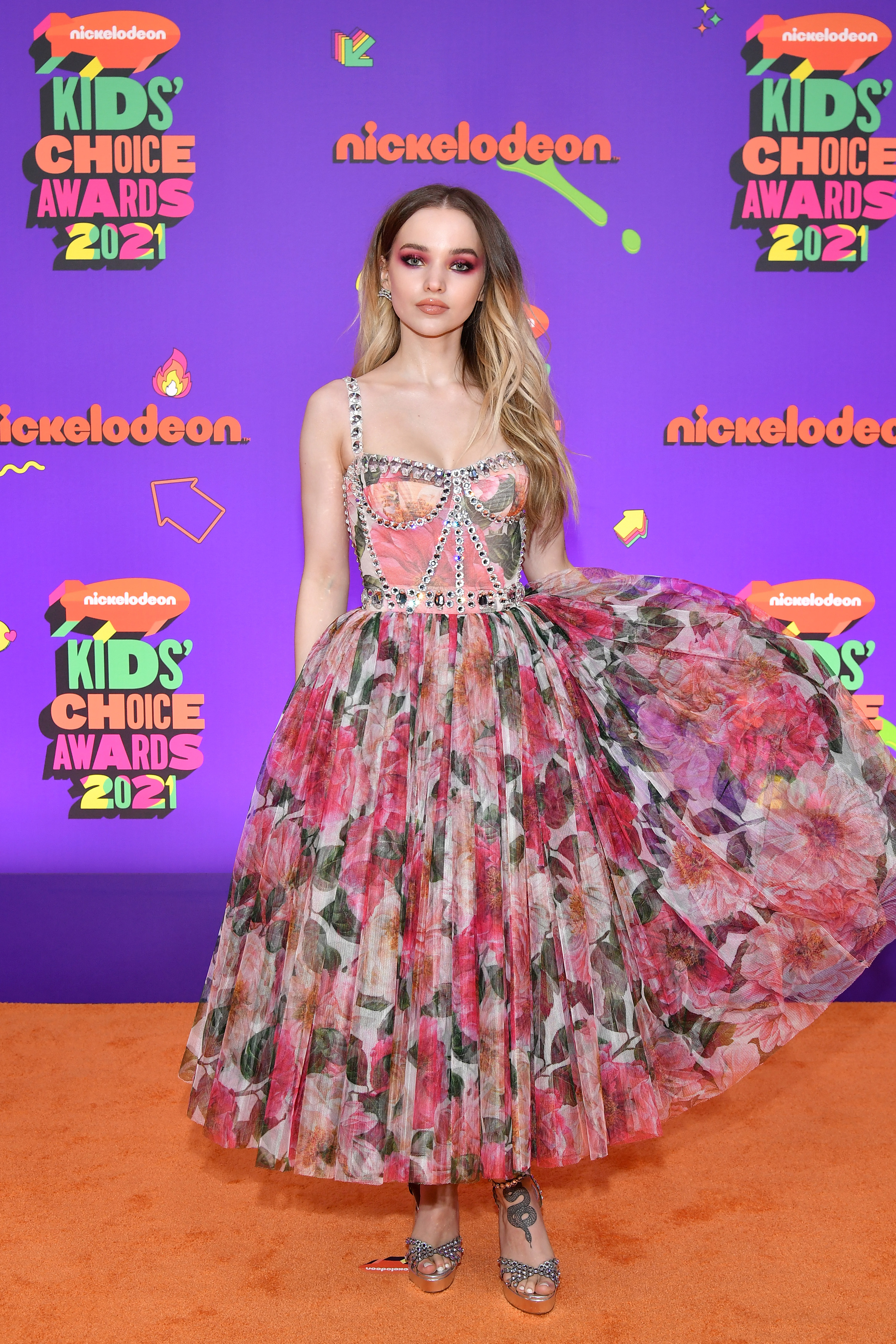 Dove in a pink floral bustier dress with long princess skirt