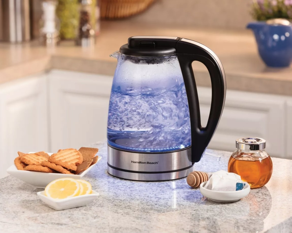 A clear water kettle with blue internal light