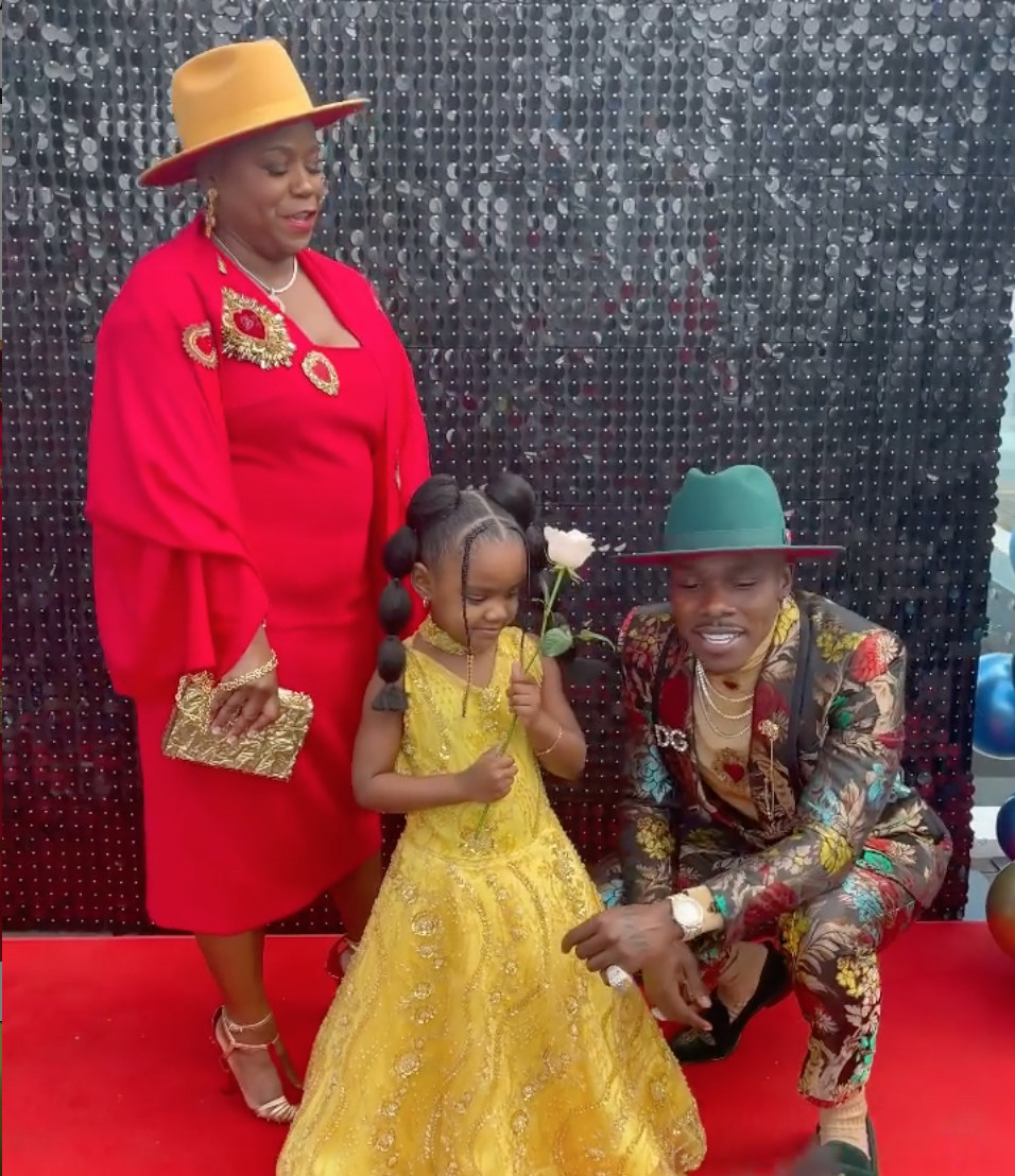 DaBaby and his daughter stage a mini Grammys red carpet at home