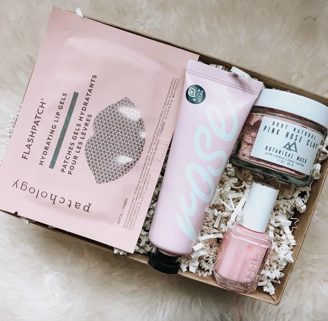 A box with nail polish, lotion, face and lip mask.