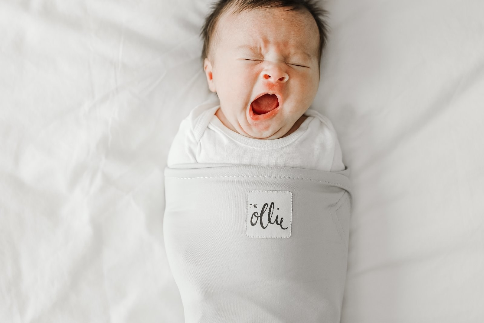 A baby in the swaddle.