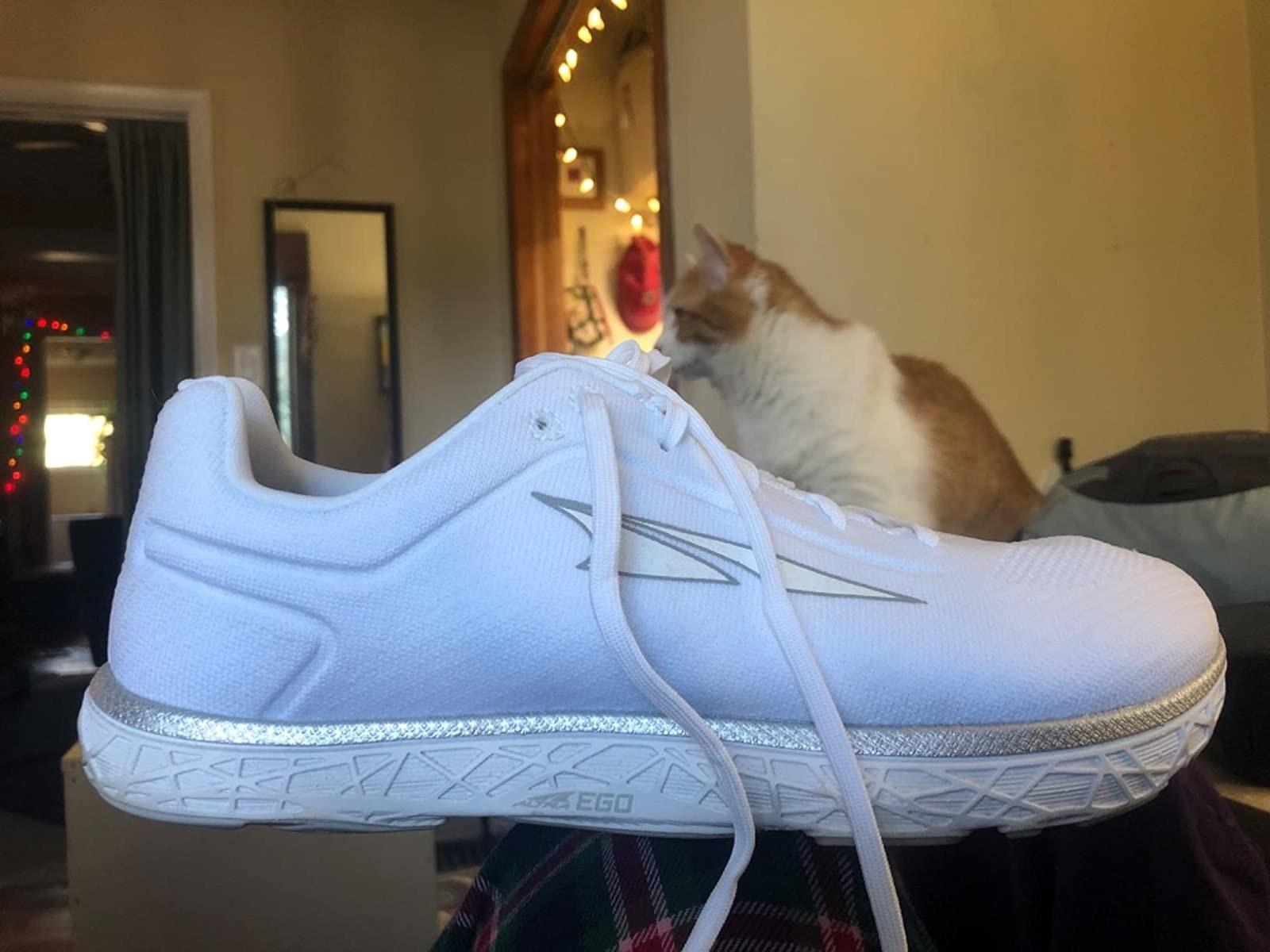 reviewer pic of white altra escalante shoe