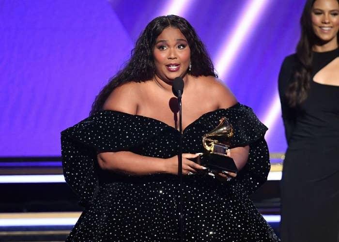 Lizzo holding her Grammy award