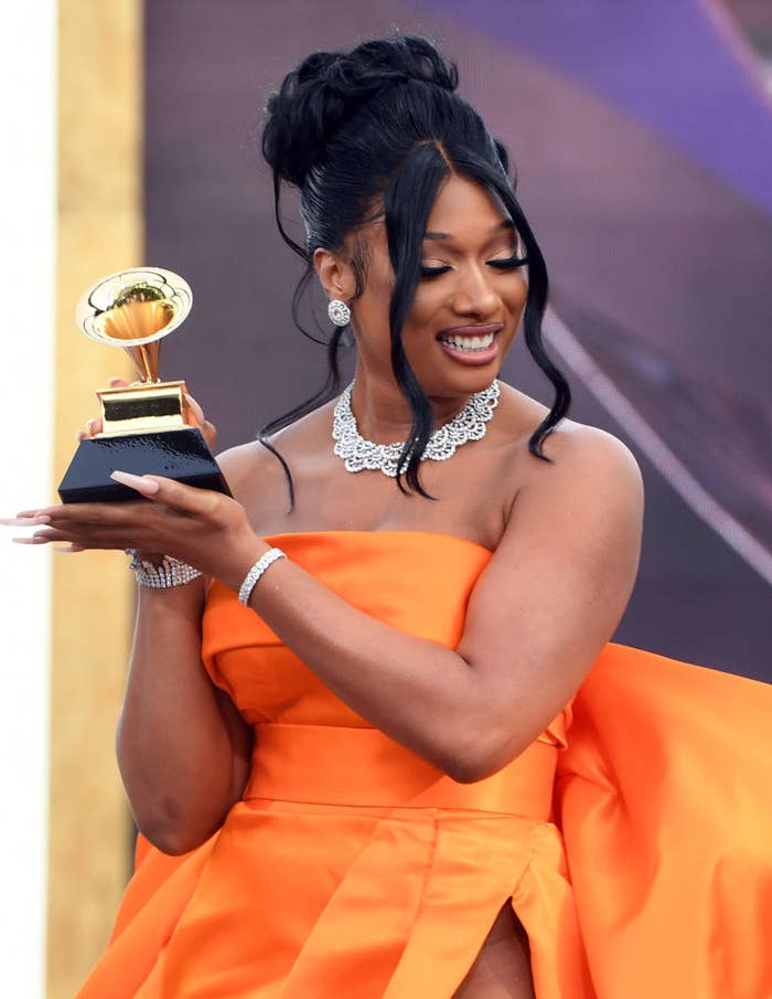 Megan Thee Stallion holdering her Grammy