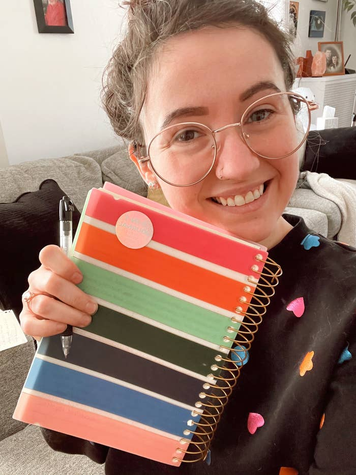 A person holding a journal