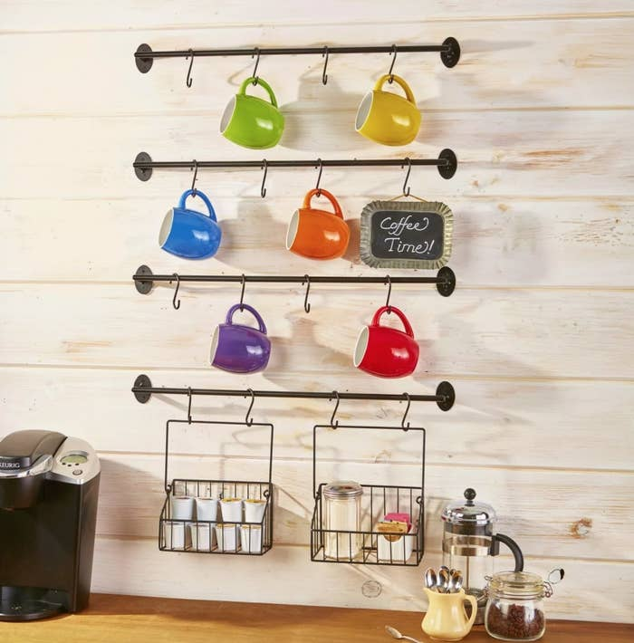 Four wall-mounted bars with hooks for mugs
