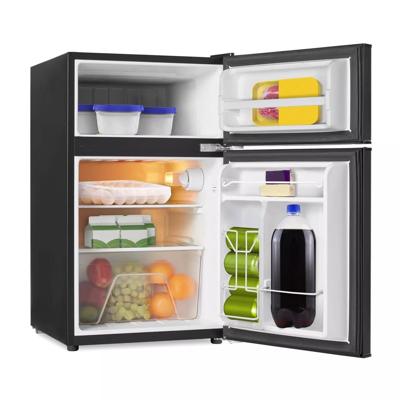 The interior of the mini fridge and freezer