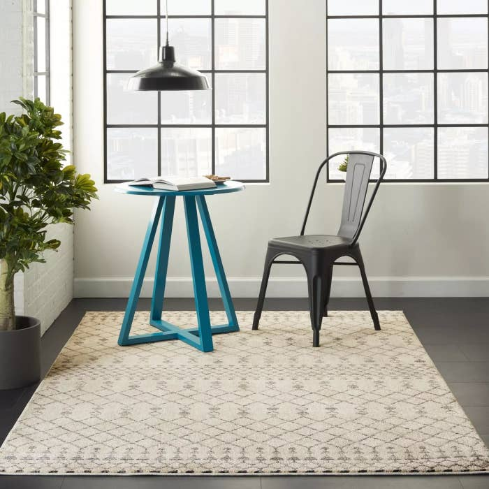 The beige and gray area rug
