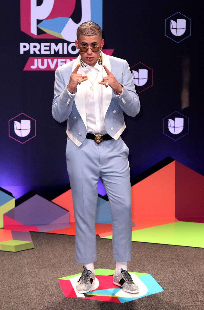 """Bad Bunny attends Univision's """"Premios Juventud"""" event in 2017 with a blue suit"""