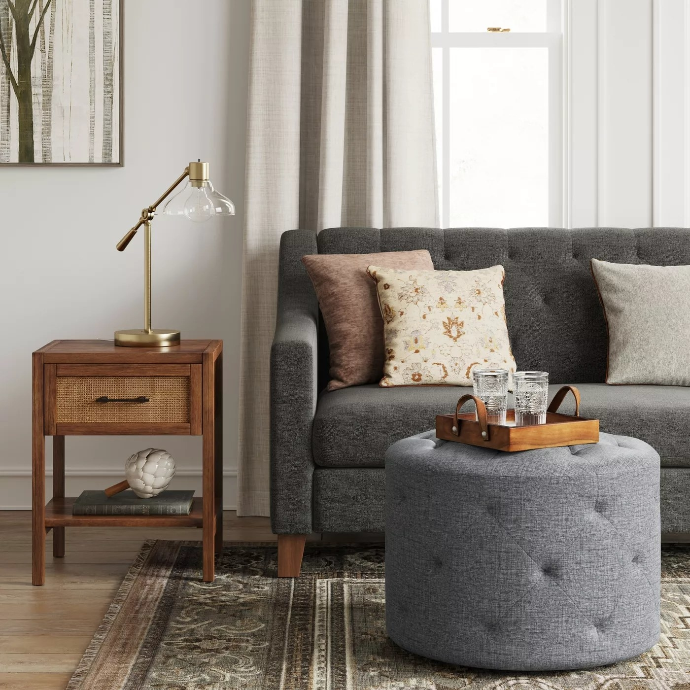 The tufted ottoman in charcoal