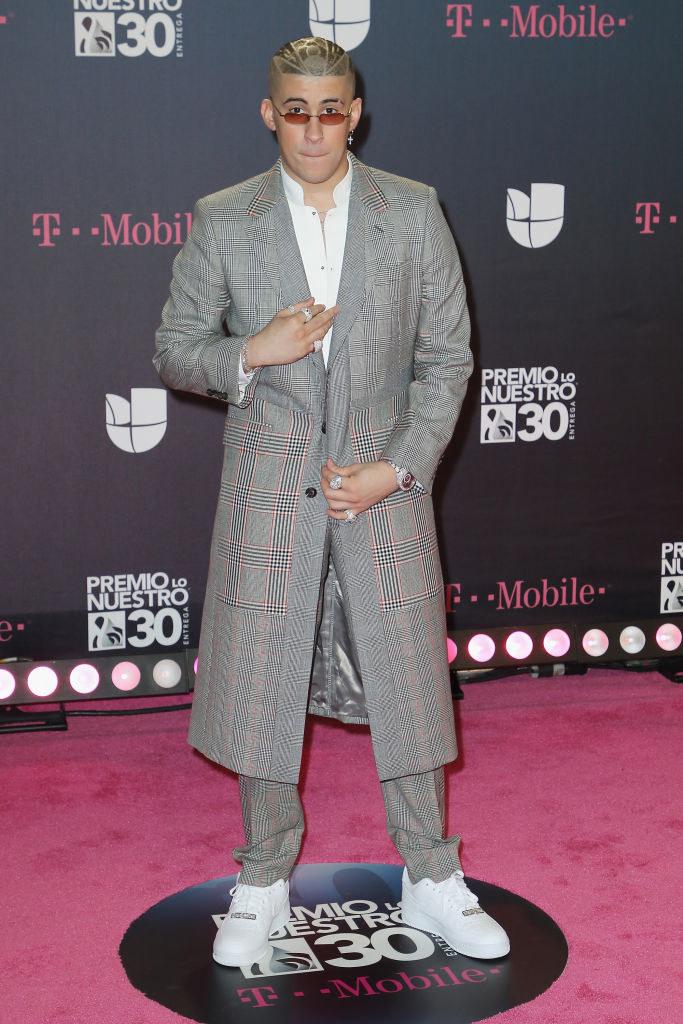 "Bad Bunny attends Univision's 30th Edition Of ""Premio Lo Nuestro A La Musica Latina"" in a gray suit"