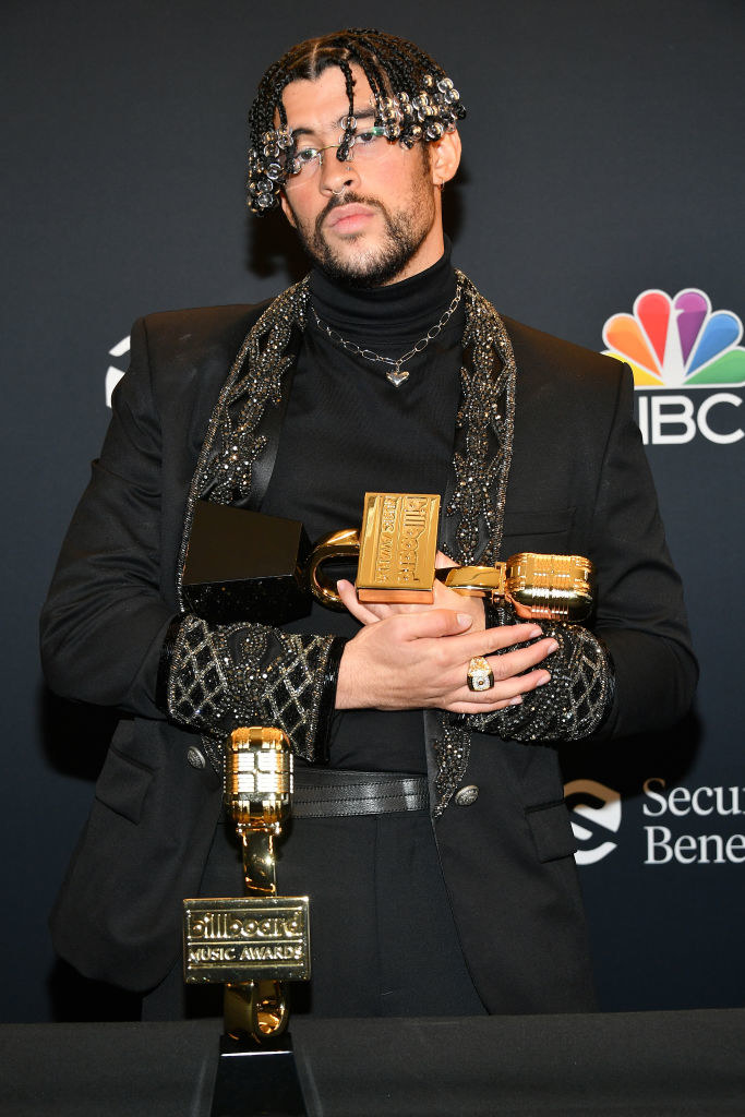 Bad Bunny poses backstage at the 2020 Billboard Music Awards in an all-black outfit