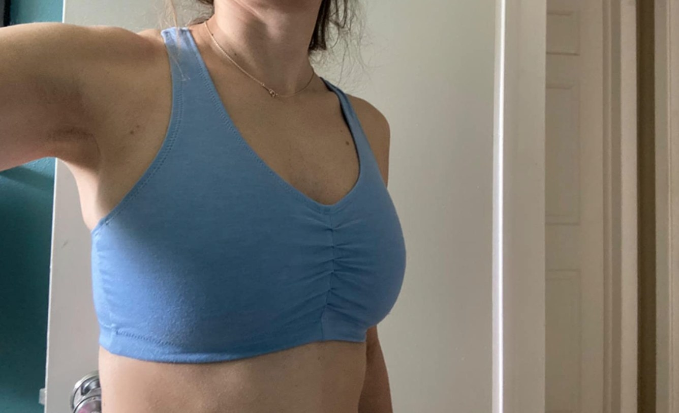 Reviewer in the sports bra with cinched middle