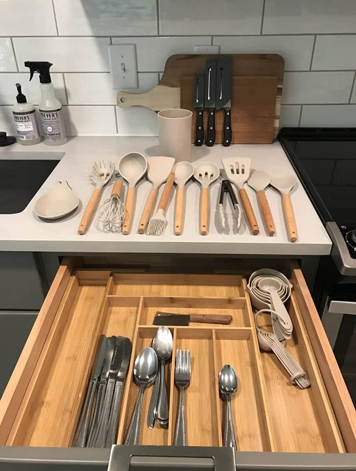 The reviewer's photo of the cookware set going in a drawer