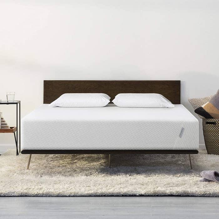 a queen mattress on a bed frame