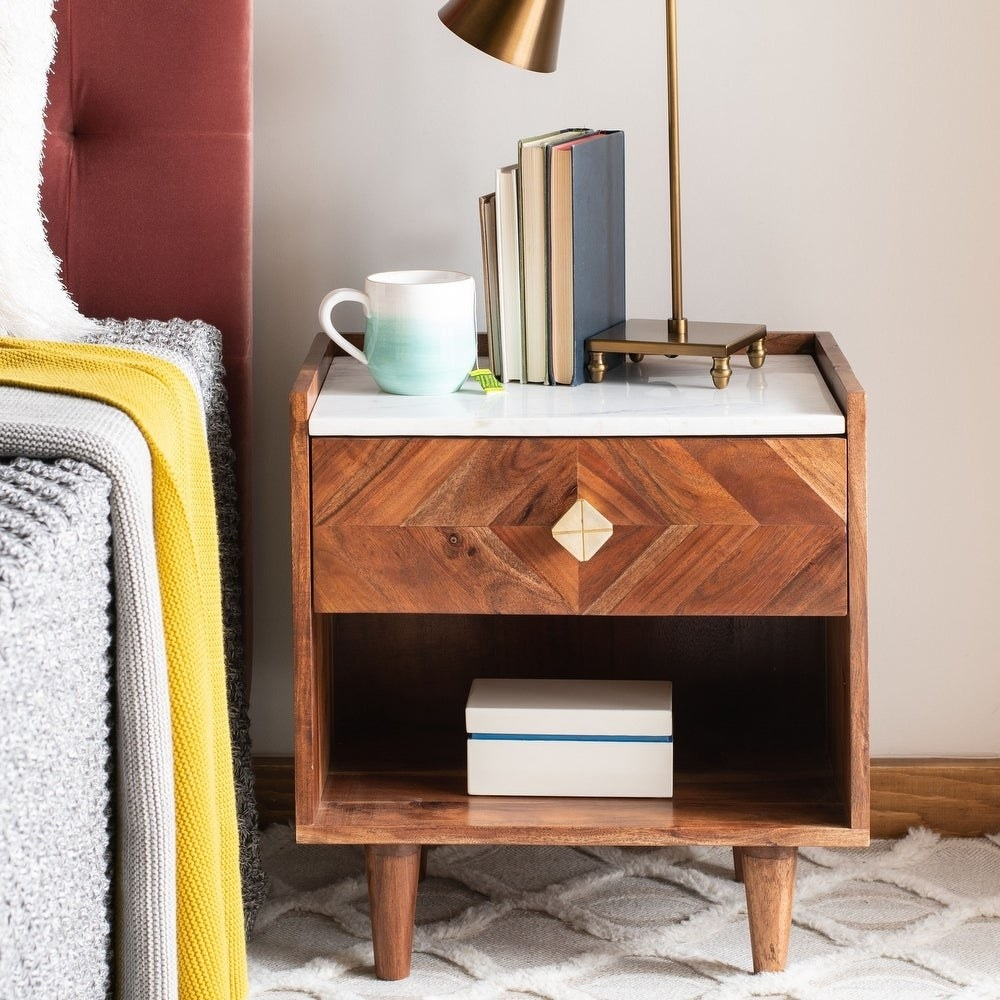 the wooden nightstand which has four mid-century modern legs and two drawers