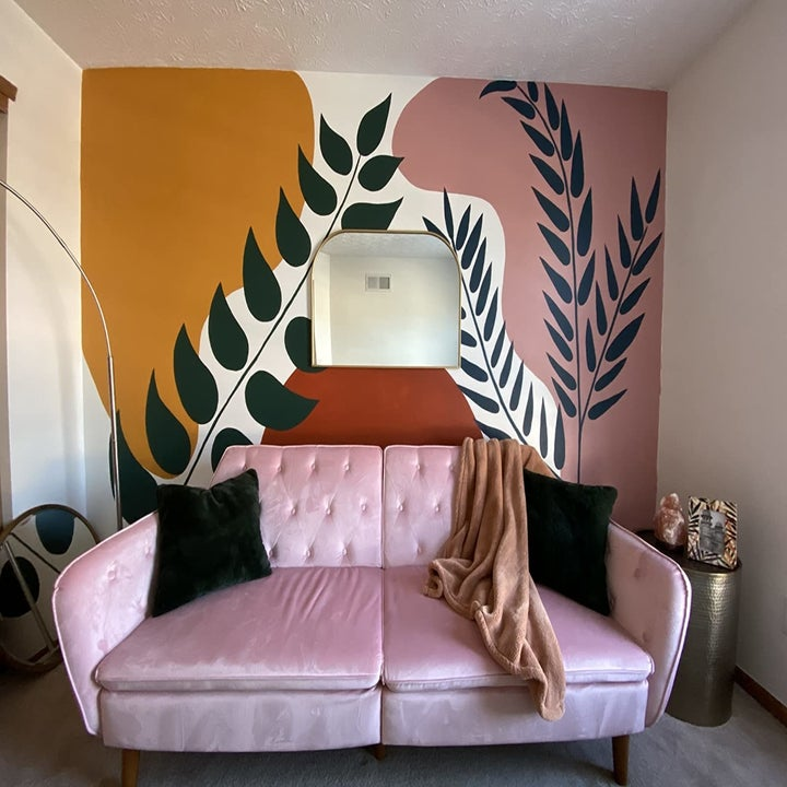 a reviewer's photo of the couch in pink