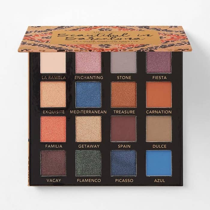 the eyeshadow palette with various shades of blue, dark red, and rose gold