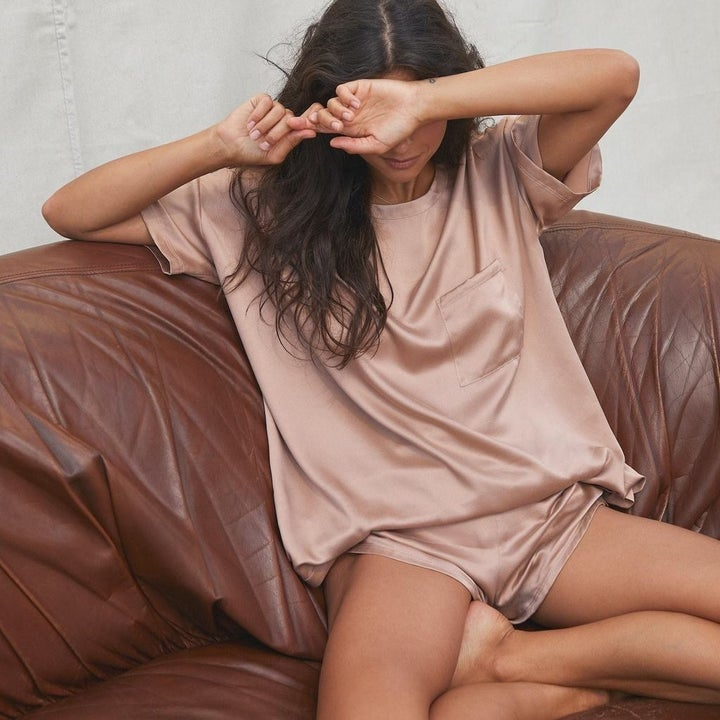 model wearing the pink silk set