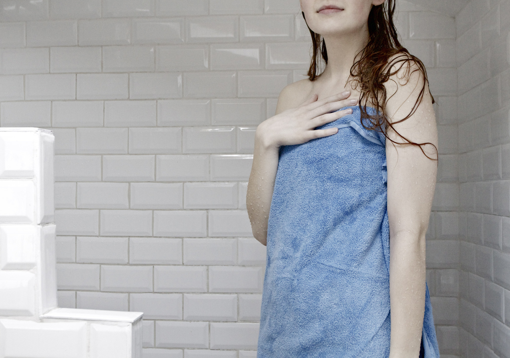 a woman stepping out of the shower