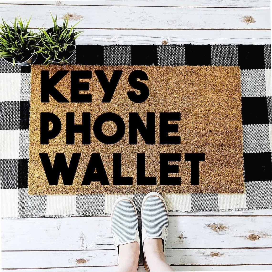 doormat that says keys phone wallet