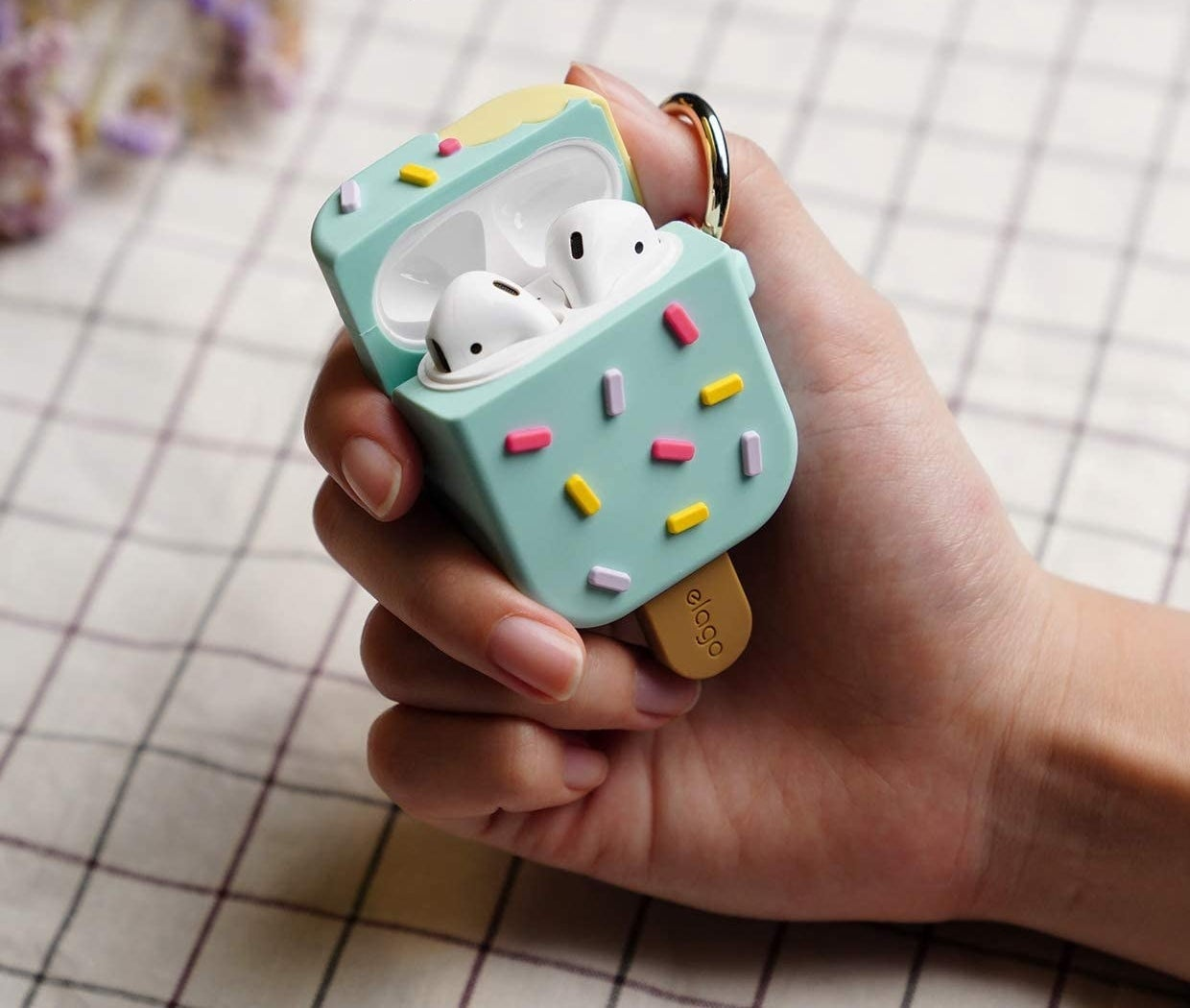 A person holding the icecream-shaped, silicone airpods case