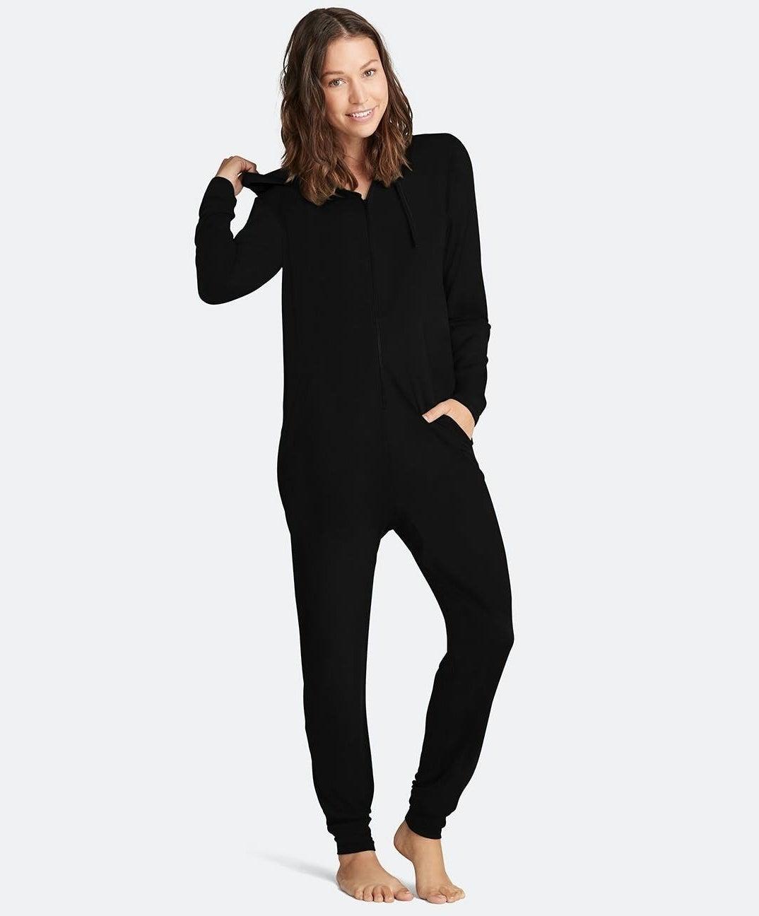 model wearing the black onesie
