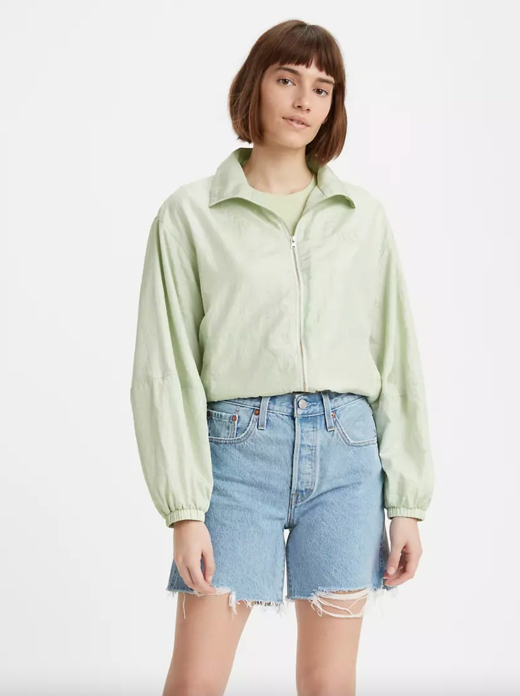Model in the cropped light green windbreaker