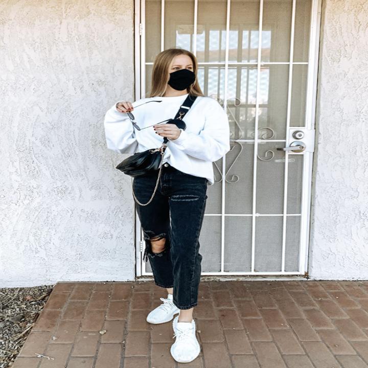 reviewer wearing crossbody bag in black
