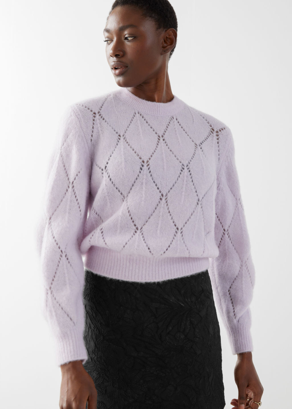 model wearing fuzzy sweater with slightly puffy sleeves
