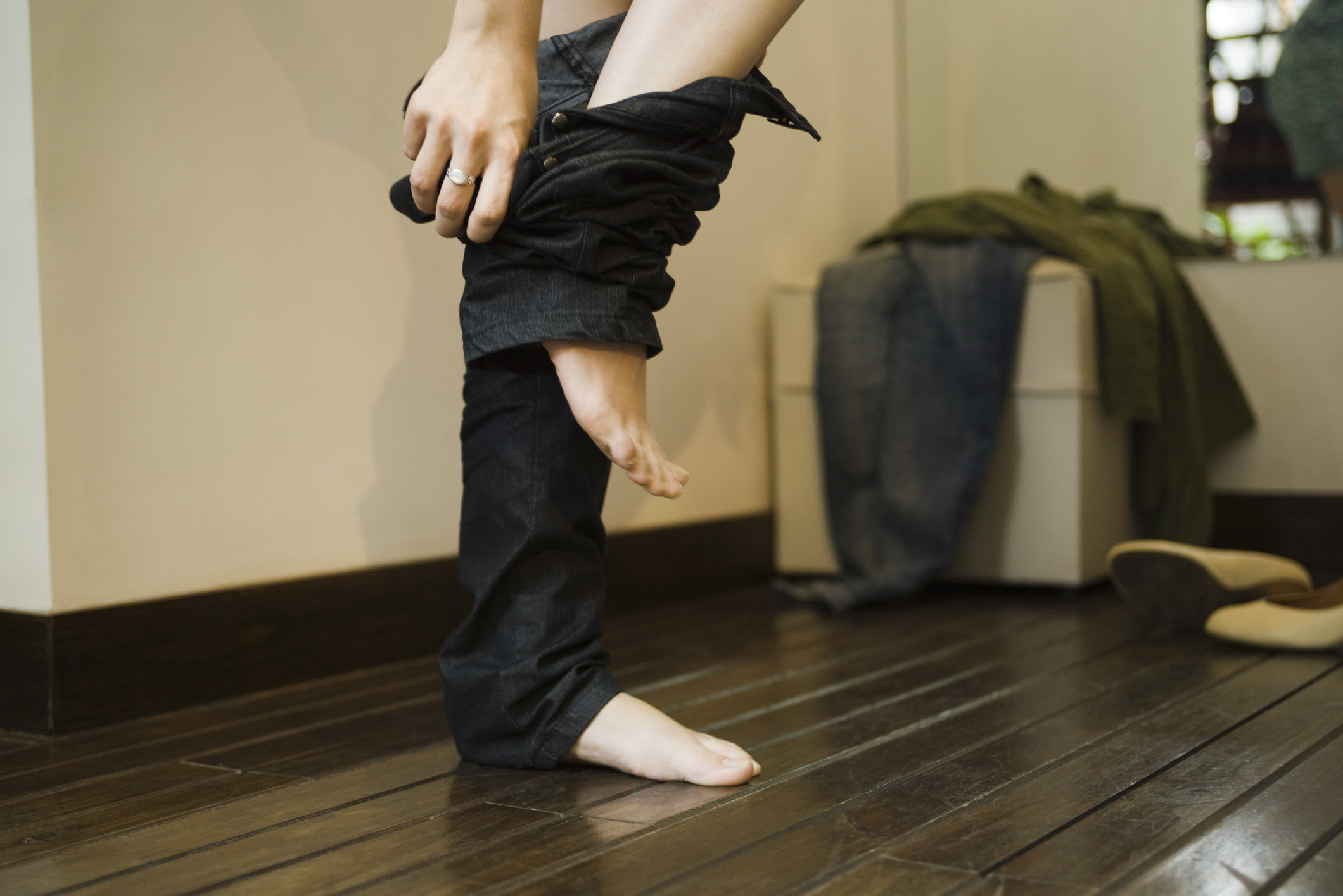 a woman removing pants
